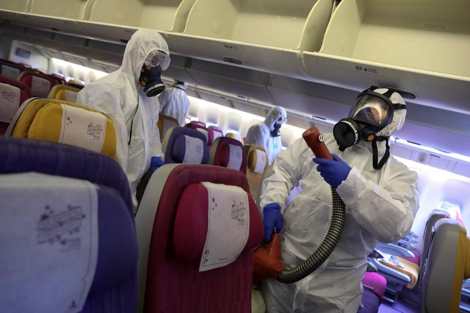 Cách phòng tránh virus corona khi đi máy bay - hinh 1