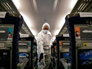 Cách phòng tránh virus corona khi đi máy bay - hinh 2